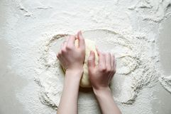 Woman Hands Kneads the Dough with Flour on the White Kitchen Tab Royalty Free Stock Photography