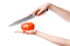 Woman hands with knife cuting tomato Royalty Free Stock Images