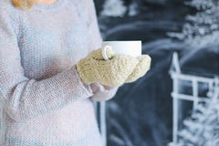 Woman hands in knitted gloves holding cup Stock Photography