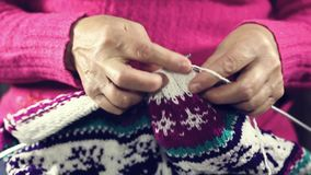Woman hands knitting colorful wool yarn. stock video footage