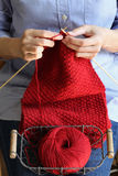 Woman hands knitting red scarf royalty free stock photography