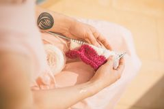 Woman hands knitwork. hobby crafts things. Top view. Horizontal composition. Lovely warm tined photo Royalty Free Stock Image