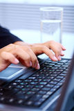 Woman hands on laptop keyboard Royalty Free Stock Photos