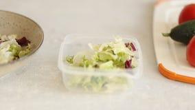 Closeup of a woman preparing a fresh salad stock footage