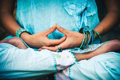 Woman hands and legs in meditative pose royalty free stock photography
