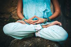 Woman hands and legs in meditative pose Stock Photo
