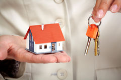 Woman Hands with little house and key. Stock Photography