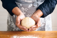 Woman hands making bread Stock Photography