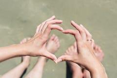 Woman hands making a heart shape Stock Photo