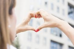 Woman hands making heart shape Royalty Free Stock Images