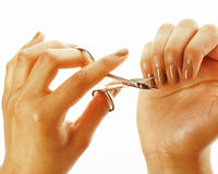 Woman hands making no qualified manicure, pedicure to herself isolated with tools Stock Images