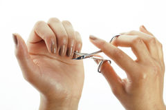 Woman hands making no qualified manicure to Royalty Free Stock Photography