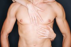 Woman hands on a man's chest Royalty Free Stock Image