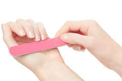 Woman hands manicure with nail file Stock Photos