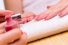 The woman hands during manicure procedure Royalty Free Stock Photo