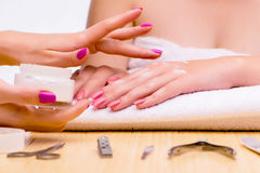 The woman hands during manicure procedure Stock Images