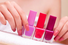 The woman hands during manicure session Stock Image