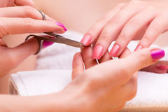 The woman hands during manicure session Royalty Free Stock Photos