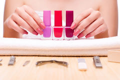 The woman hands during manicure session Stock Photos