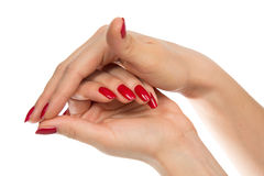 Woman hands with manicured red nails isolated Royalty Free Stock Photos