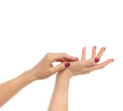 Woman hands with manicured red nails isolated Stock Images