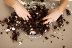 Woman hands messy in cake Stock Photos