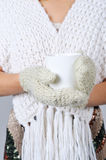 Woman hands in mittens holding cup Stock Image