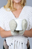 Woman hands in mittens holding cup Stock Photography