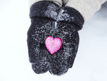 Woman hands in mittens with red heart on snow Royalty Free Stock Images