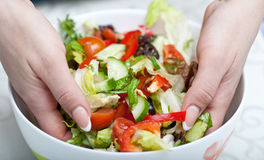 Woman hands mixes salad Stock Photos