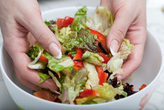 The woman hands mixes salad Royalty Free Stock Images