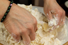 Woman hands mixing dough Stock Photography