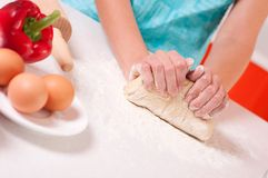Woman hands mixing dough on the table Stock Photos