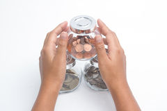 Woman hands with money in glass jar. Protection of retirement savings Royalty Free Stock Photography