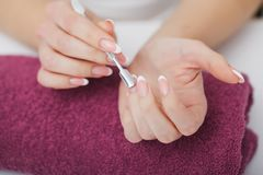 Woman hands in a nail salon receiving a manicure procedure. SPA Royalty Free Stock Photos