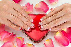 Woman Hands With Nail Varnish On Make-up Box Royalty Free Stock Images