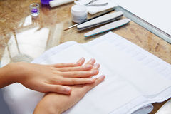 Woman hands with nails before treatment Royalty Free Stock Photo