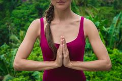 Woman hands in Namaste prayer mudra. Symbolic gesture in Hinduism, Buddhism Stock Photo