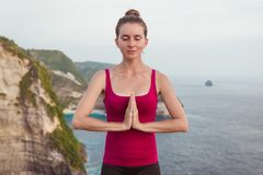 Woman hands in Namaste prayer mudra. Symbolic gesture in Hinduism, Buddhism Stock Image