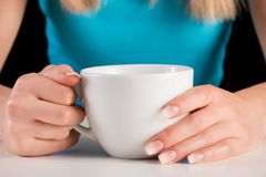Woman hands with Ombre manicure holding cup of coffee or tea royalty free stock images