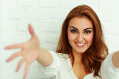 Woman with hands open trying to reach the camera Royalty Free Stock Photography