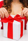 Woman hands opening gift boxes Stock Photos