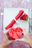Woman hands opening heart-shaped box Royalty Free Stock Photos