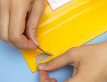 Woman hands opening mail envelope Stock Image
