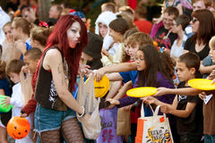 Woman Hands Out Candy At Halloween Parade Stock Photo