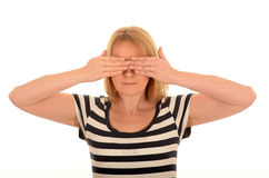 Woman with hands over her eyes Royalty Free Stock Photo