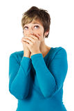 Woman with hands over her mouth Royalty Free Stock Photos