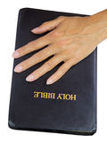 Woman hands over holy bible Stock Images