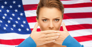 Woman with hands over mouth Stock Photo