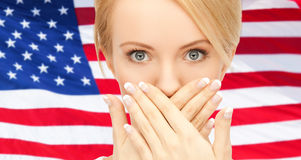 Woman with hands over mouth Stock Photos